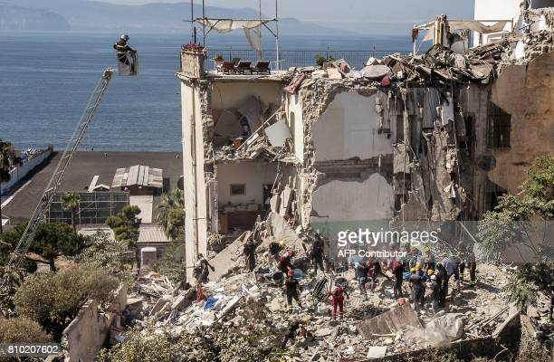 Firefighters search the rubble after two floors collapsed in a small four-storey building in Torre Annunziata, in a town near the Italian city of...