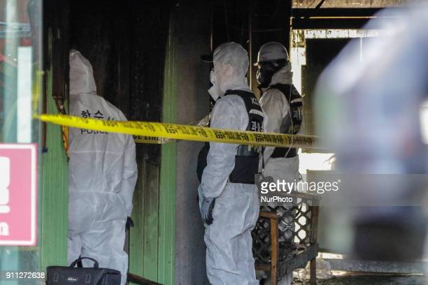 Firefighters search throught debris in an emergency room of a damaged hospital building after a fire in Miryang on January 26 2018 A huge fire tore...