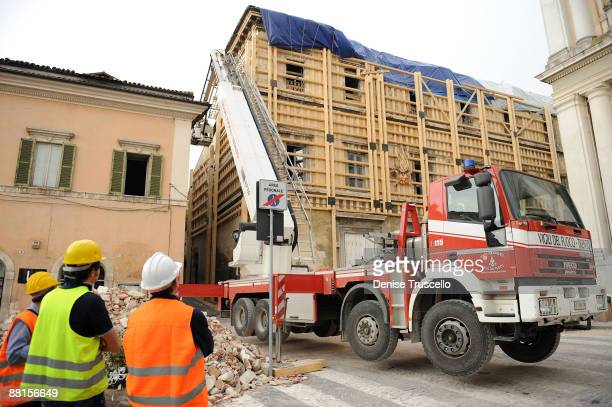 Firefighters secure a historic building in L'Aquila, which was destroyed in the 6.3 magnitude earthquake that struck the Abruzzo region on April 6,...
