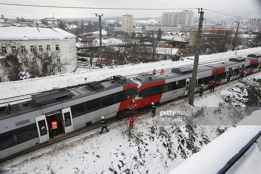 Firefighters secure the site where two trains of the line S45 stand off rail after having crashed on January 21, 2013 in Vienna, Austria