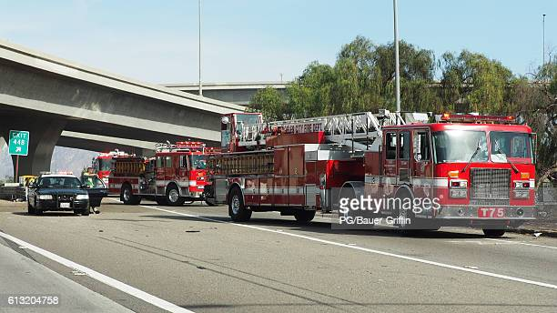 Firefighters seen battling a brush fire at the intersection of the 118 and 5 freeways on October 07 2016 in Los Angeles California