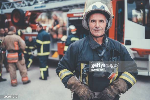 firefighter's senior portrait - rescue worker stock pictures, royalty-free photos & images