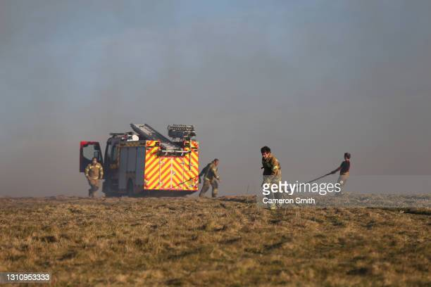 Firefighters setup water hoses on April 05, 2021 in Land's End, England. Cornwall Fire and Rescue Service said they started battling the blaze around...
