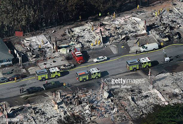 Firefighters sift through rubble at burned homes that were destroyed by a massive explosion and fire September 10 2010 in San Bruno California Thirty...