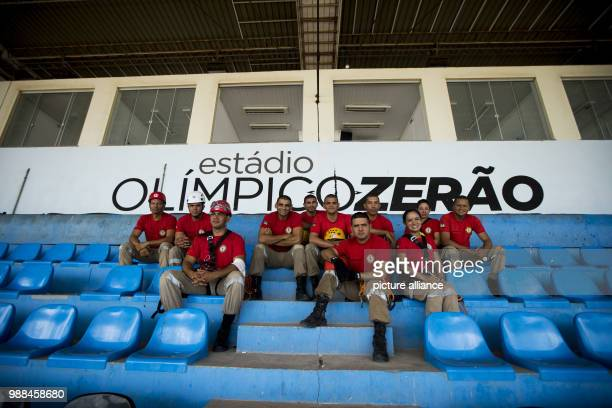 Firefighters sit inside the Zerao soccer stadium in Macapa Brazil 17 November 2017 Measurements show that the equator draws through this arena...
