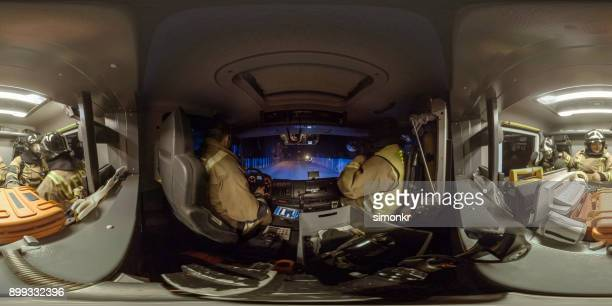 Firefighters sitting in fire engine