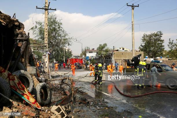 Firefighters spray water at the site of an explosion targeting the convoy of Afghanistan's vice president Amrullah Saleh in Kabul on September 9,...