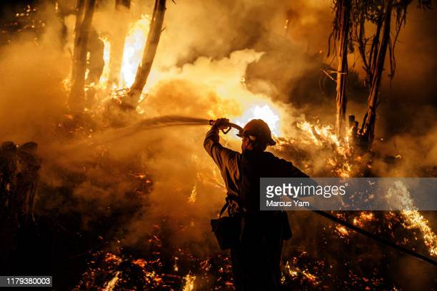 PAULA CALIF FRIDAY NOVEMBER 1 2019 Firefighters sprays water on a back fire while battling the spread of the Maria Fire as it moves quickly towards...