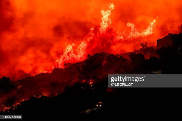 TOPSHOT Firefighters stage trucks on Painted Cave Road as the Cave fire burns a hillside in Santa Barbara California on November 26 2019 The...