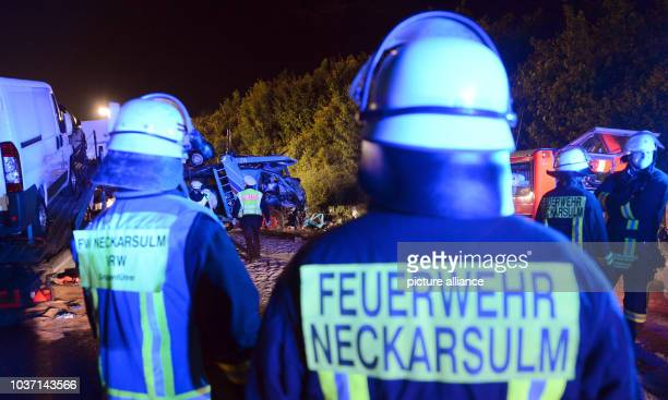 Firefighters stand on the Autobahn after an accident near Neckarsulm Germany 28 May 2013 Two trucks were involved in the accident in which two people...