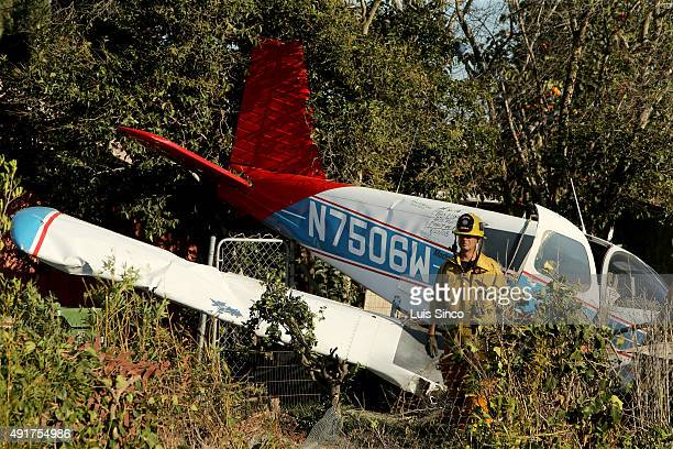 COMPTON CALIF OCT 7 2015 A firefighters surveys the scene of a plane crash in the back yard of a home near the intersection of Reeves Street and...