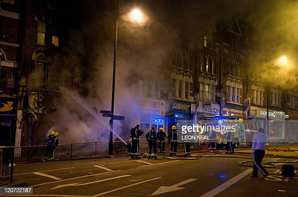 Firefighters tackle a blaze at a business in Clapham Junction south London on 8 August 2011 Now in it's third night of unrest London has seen...