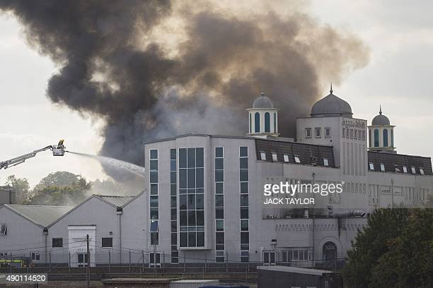 Firefighters tackle a blaze at the Baitul Futuh Mosque in Morden south west London on September 26 2015 Around 70 firefighters are tackling the blaze...