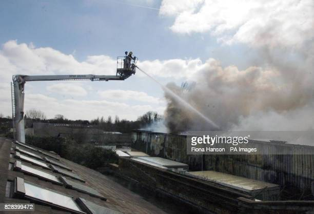 Firefighters tackle a blaze in the warehouse of STS Flooring Distributors Green Lane Penge London Sunday 19 March 2006 London Fire Brigade were...