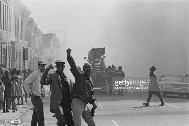 Firefighters tackle a burning building during a period of rioting in Baltimore Maryland following the assassination of civil rights activist Martin...