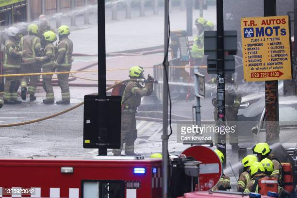 Firefighters tackle a fire nearby the Elephant & Castle Rail Station on June 28, 2021 in London, England. London Fire Brigade has said that 70...