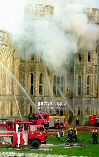 Firefighters tackle a huge blaze in the center of Windsor Castle 20 November 1992. Flames ripped through private apartments in the east wing of the...