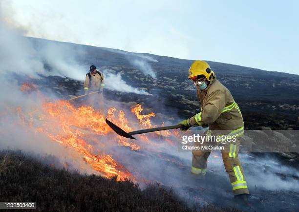 Firefighters tackle the blaze on Slieve Donard mountain on April 24, 2021 in Newcastle, Northern Ireland. The Northern Ireland Fire and Rescue...