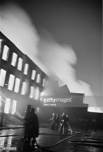 Firefighters tackling a blaze during the Blitz London 1941 Original publication Picture Post 587 FireFighters pub 1st February 1941