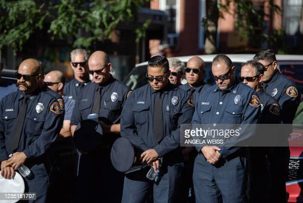 Firefighters take part in a moment of silence on the 20th anniversary of the 9/11 attacks on the World Trade Center in New York, on September 11,...
