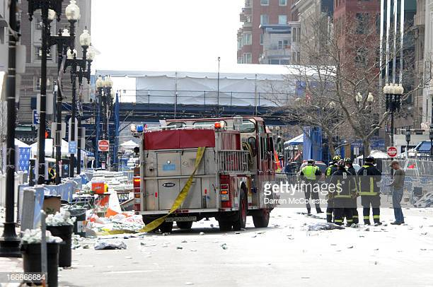 Firefighters take postion on Boyltson Street near the finish line after two bombs exploded during the 117th Boston Marathon on April 15 2013 in...