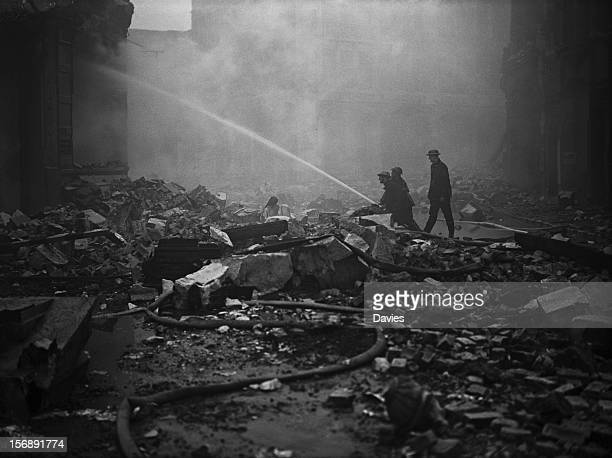 Firefighters target a blaze in the Guildhall in the City of London following a German air raid during The Blitz World War II 30th December 1940