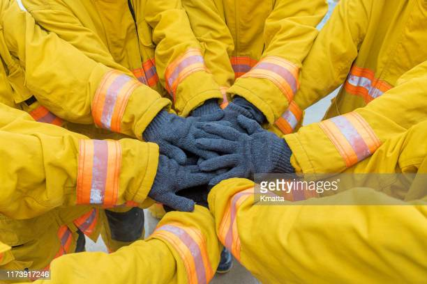 firefighters teamwork - rescue worker stock pictures, royalty-free photos & images
