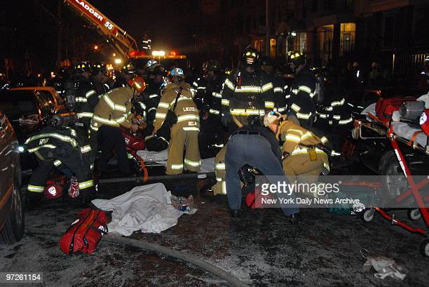 Firefighters tend to victims of threealarm fire in apartment blaze at 1022 Woddycreast Ave near W 165th St in High Bridge the Bronx The fire killed...