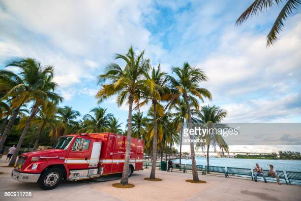 firefighters truck parked in miami downtown park, florida, usa - miami dade county stock photos and pictures