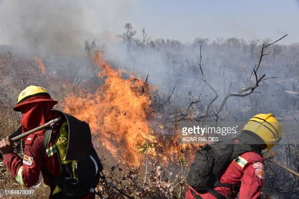 Firefighters try to control a fire near Charagua, Bolivia, in the border with Paraguay, south of the Amazon basin, on August 29, 2019. - Fires have...