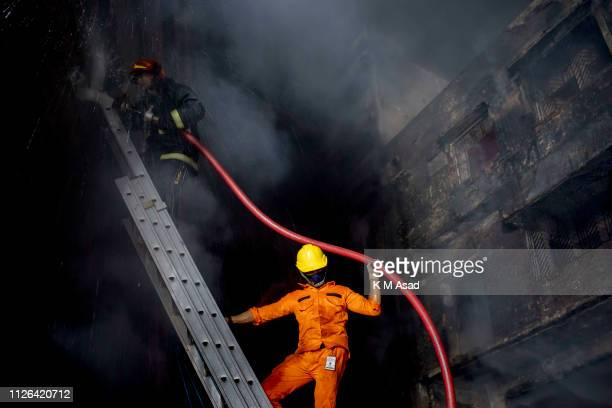 Firefighters try to control a fire which broke out from a chemical warehouse at Lalbag in Dhaka At least 10 people died and 50 people were injured...