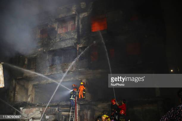 Firefighters try to control fire at Chawkbazar old part of Dhaka city Bangladesh on February 21 2019 At least five people have been killed and 50...