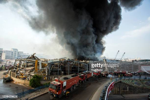 Firefighters try to douse flames billowing from a huge fire that broke out at a warehouse at the Beirut's sea port, Lebanon, on September 10, 2020 a...