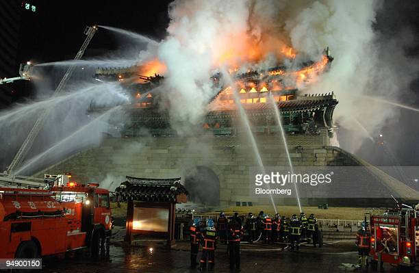 Firefighters try to extinguish a fire at Sungnyemun Gate also called Namdaemun or South Gate in Seoul South Korea on Monday Feb 11 2008 Fire...