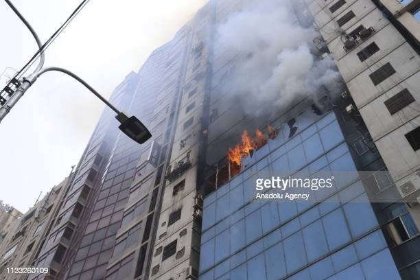 Firefighters try to extinguish a fire broke out at a highrise in Dhakas Banani what was yet to be brought under control even after three hours of...