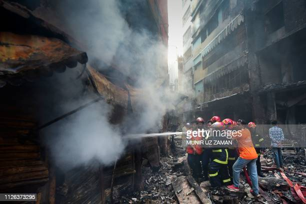Firefighters try to extinguish a fire in Dhaka on February 21 2019 At least 69 people have died in a huge blaze that tore through apartment buildings...