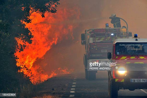 Firefighters try to extinguish a fire on August 16 nearby the French sea resort of Lacanau, on the Atlantic coast. The fire has destroyed about 40...