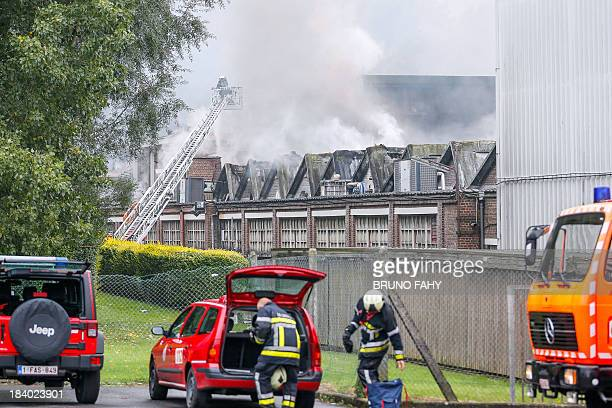 Firefighters try to extinguish a fire on October 11 2013 at the Lutti confectionery factory in Manage The fire broke out in the factory after an...