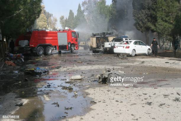 Firefighters try to extinguish a fire that broke out after a suicide bombing terrorist attack as security forces cordon the area in Helmand Province...