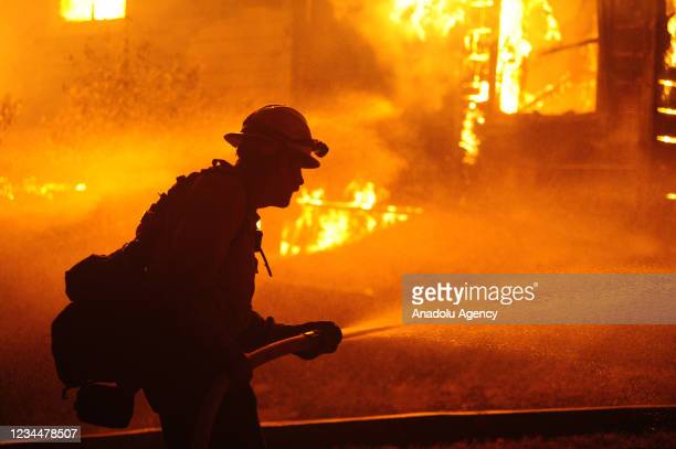 Firefighters try to extinguish Dixie Fire near Chico in Greenville, California, United States on August 5, 2021. The Dixie Fire took a turn for the...