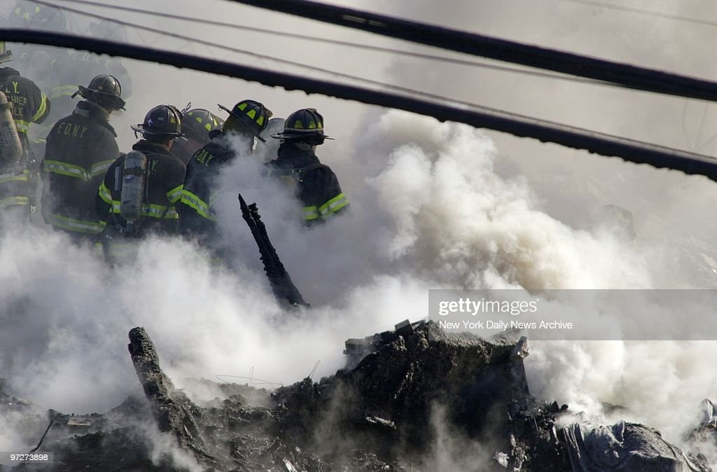 Firefighters try to get fire under control and look for vict : News Photo