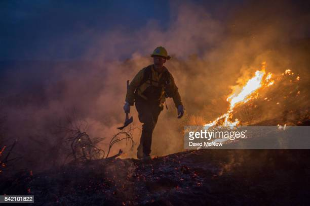 Firefighters use hand tools in chaparral brush to fight the La Tuna Fire on September 2 2017 near Burbank California Los Angeles Mayor Eric Garcetti...