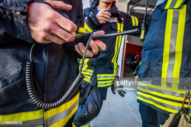 firefighters using walkie talkie, rescue operation close up - rescue worker stock pictures, royalty-free photos & images