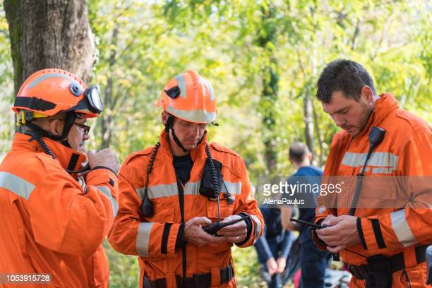 firefighters using walkie talkie, rescue operation - rescue worker stock pictures, royalty-free photos & images