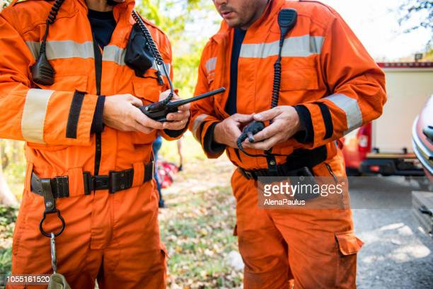 firefighters using walkie talkie, rescue operation - emergencies and disasters stock pictures, royalty-free photos & images