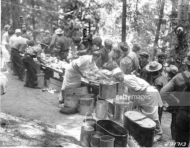 Firefighters wait for food in the mess line at Camp fighting the Selway Falls Fire Kaniksu National Forest Idaho USA