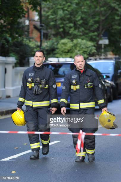 Firefighters walks through the street around the Parsons Green Underground Station Several injured at Parsons Green as passengers report seeing...