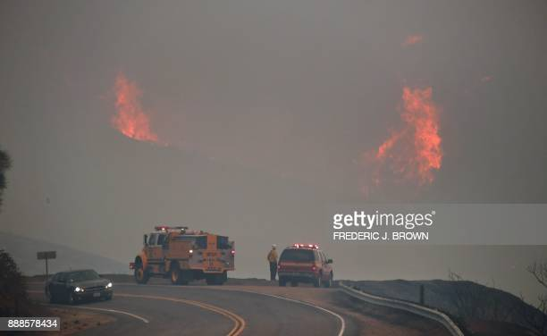 TOPSHOT Firefighters watch as flames erupt on mountainsides in the Los Padres national Forest north of Ojai California on December 8 2017 Unrelenting...