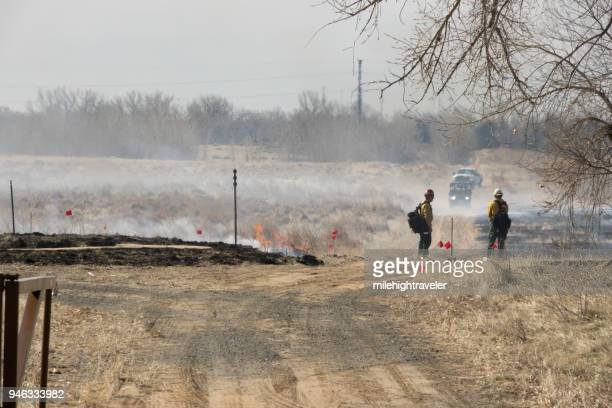 Firefighters watch controlled fire burn Rocky Mountain Arsenal National Wildlife Refuge Commerce City Colorado
