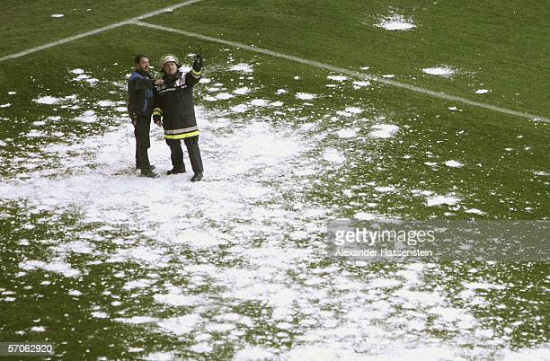 Firefighters watch the falling snow from the stadium roof before the Bundesliga match between Hamburger SV and 1 FC Kaiserslautern at the AOL Arena...